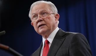 Attorney General Jeff Sessions speaks during a news conference to announce a criminal law enforcement action involving China, at the Department of Justice in Washington, Thursday, Nov. 1, 2018. Justice Department and FBI leaders announced criminal charges and an operation to thwart Chinese economic espionage. (AP Photo/Pablo Martinez Monsivais)