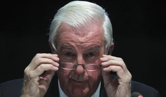 FILE - In this Thursday, Nov. 16, 2017 file photo, World Anti-Doping Agency (WADA) President Craig Reedie adjusts his glasses during a press conference in Seoul. World Anti-Doping Agency President Craig Reedie said on Thursday, Nov. 1, 2018 his wife threatened to divorce him if he didn't resign from the organization amid the furor over the Russia investigation. Critics say because Reedie is a member of the International Olympic Committee his objectivity has been compromised. (AP Photo/Lee Jin-man, file)