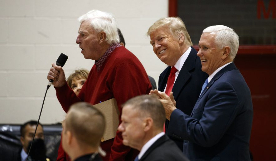 President Donald Trump and Vice President Mike Pence smile as former basketball coach Bob Knight speaks to an overflow crowd at a campaign rally at Southport High School, Friday, Nov. 2, 2018, in Indianapolis. (AP Photo/Evan Vucci)