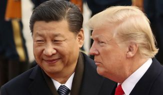 "In this Nov. 9, 2017, photo, U.S. President Donald Trump and Chinese President Xi Jinping participate in a welcome ceremony at the Great Hall of the People in Beijing, China. Mr. Xi had an ""extremely positive"" phone conversation with Mr. Trump about trade and other issues, the foreign ministry said Friday, Nov. 2, 2018. The two leaders agreed to ""strengthen economic exchanges,"" said a ministry spokesman, Lu Kang. (AP Photo/Andrew Harnik, File)"