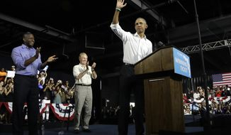 Former President Barack Obama, right, waves during a campaign rally with Democratic gubernatorial candidate Andrew Gillum, left, and U.S. Sen. Bill Nelson, D-Fla., center, Friday, Nov. 2, 2018, in Miami. (AP Photo/Lynne Sladky)