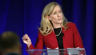 In this Oct. 15, 2018, file photo, Abigail Spanberger gestures during a debate with Virginia Congressman Dave Brat, R-Va., at Germanna Community College in Culpeper, Va. (AP Photo/Steve Helber)