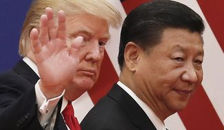 FILE - In this Nov. 9, 2017, file photo, Chinese President Xi Jinping walks with U.S. President Donald Trump after attending a business event at the Great Hall of the People in Beijing. Xi promised tax cuts and other help to China's entrepreneurs in a renewed effort to revive growth in a cooling, state-dominated economy amid a mounting tariff battle with Washington. Xi's comments, reported Friday, Nov. 2, 2018, by state media, follow a decline in Chinese economic growth to a post-global crisis low of 6.5 percent over a year ago in the three months ending in September. (AP Photo/Andy Wong, File)