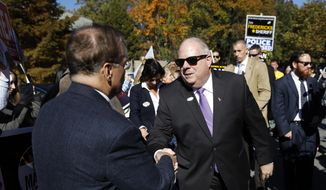 Maryland Gov. Larry Hogan greets supporters outside a polling place after voting early, in Annapolis, Md.  (AP Photo/Patrick Semansky, File)