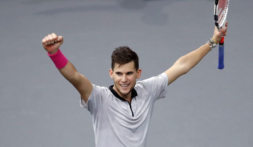 Austria's Dominic Thiem celebrates after defeating Jack Sock of the U.S. during their quarter-final match of the Paris Masters tennis tournament at the Bercy Arena in Paris, France, Friday, Nov. 2, 2018. (AP Photo/Christophe Ena)