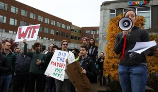Alice Lemieux addresses fellow Google employees as they take part in a protest against what they said is the tech company's mishandling of sexual misconduct allegations against executives Thursday, Nov 1, 2018, in Seattle. (Alan Berner/The Seattle Times via AP)