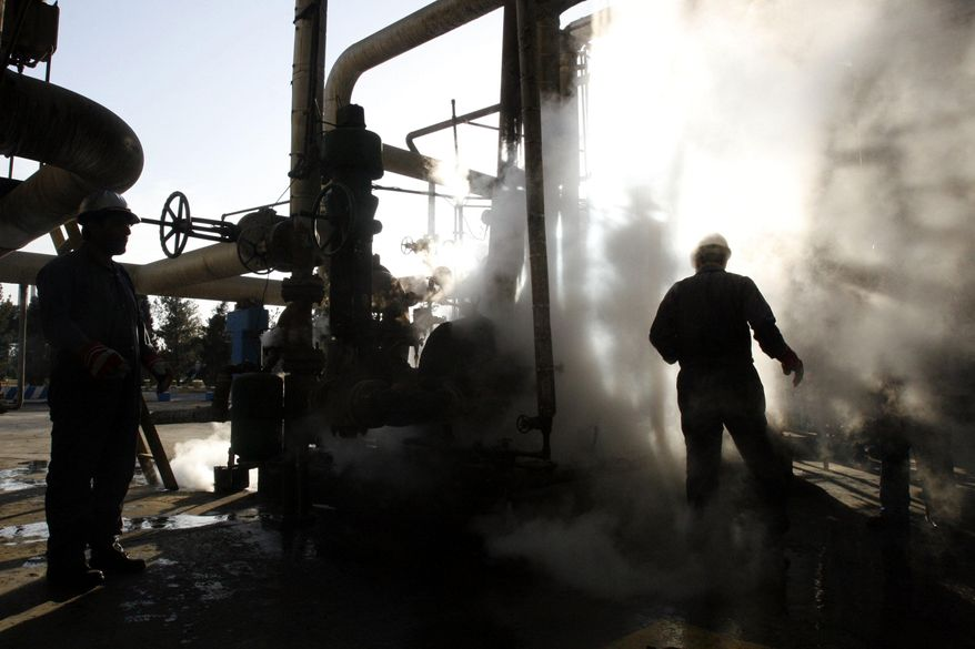 In this Nov. 17, 2007, file photo, a worker repairs a part of a unit of the Tehran oil refinery, in Tehran, Iran. (AP Photo/Vahid Salemi, File)
