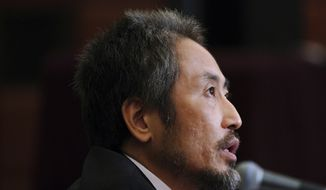 Japanese journalist Jumpei Yasuda, who was released in Syria last week after more than three years of captivity, speaks during his press conference in Tokyo Friday, Nov. 2, 2018. (AP Photo/Eugene Hoshiko)