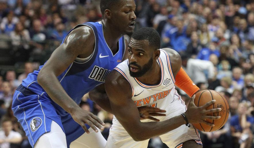 Dallas Mavericks forward Dorian Finney-Smith (10) defends as New York Knicks guard Tim Hardaway Jr. (3) looks for an opening in the first half of an NBA basketball game Friday, Nov. 2, 2018, in Dallas. (AP Photo/Richard W. Rodriguez)