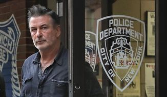 Actor Alec Baldwin walks out of the New York Police Department's 10th Precinct, Friday, Nov. 2, 2018, in New York. Baldwin was arrested Friday after allegedly punching a man in the face during a dispute over a parking spot outside his New York City home, authorities said. (AP Photo/Julie Jacobson) **FILE**