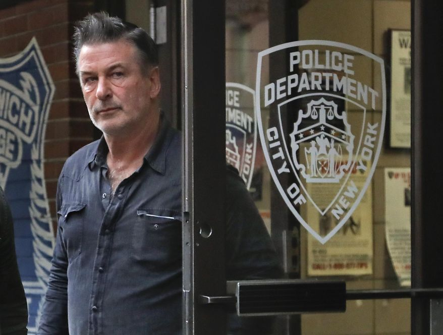 Actor Alec Baldwin walks out of the New York Police Department's 10th Precinct, Friday, Nov. 2, 2018, in New York. Baldwin was arrested Friday after allegedly punching a man in the face during a dispute over a parking spot outside his New York City home, authorities said. (Photo/Julie Jacobson) ** FILE **