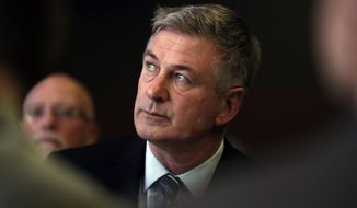 In this Nov. 27, 2017 file photo, actor Alec Baldwin waits to speak during the Iowa Democratic Party's Fall Gala, in Des Moines, Iowa. Baldwin has been arrested for allegedly punching someone during a dispute over a New York City parking spot. Police say the actor was taken into custody just before 2 p.m. on Friday, Nov. 2, 2018, in Manhattan's West Village neighborhood.(AP Photo/Charlie Neibergall, File)