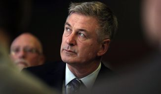 FILE - In this Nov. 27, 2017 file photo, actor Alec Baldwin waits to speak during the Iowa Democratic Party's Fall Gala, in Des Moines, Iowa. Baldwin has been arrested for allegedly punching someone during a dispute over a New York City parking spot. Police say the actor was taken into custody just before 2 p.m. on Friday, Nov. 2, 2018, in Manhattan's West Village neighborhood.(AP Photo/Charlie Neibergall, File)