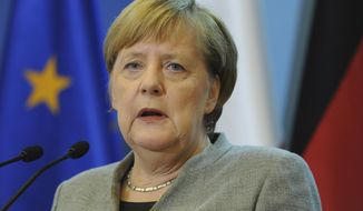 German Chancellor Angela Merkel speaks during a press conference after talks between the governments of Poland and Germany in Warsaw, Poland, Friday, Nov. 2, 2018. (AP Photo/Alik Keplicz)