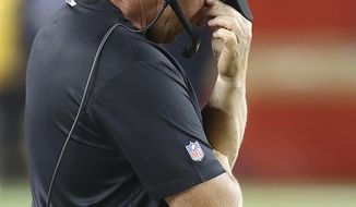 Oakland Raiders coach Jon Gruden covers his face on the sideline during the second half of the team's NFL football game against the San Francisco 49ers in Santa Clara, Calif., Thursday, Nov. 1, 2018. (AP Photo/Ben Margot)