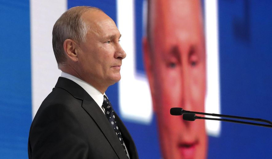 President Vladimir Putin speaks at a the community of active citizens forum in Moscow, Russia, Friday, Nov. 2, 2018 . Putin hailed the agency, saying that he highly appreciates intelligence information and analytics it provides. (Alexei Druzhinin, Sputnik, Kremlin Pool Photo via AP)