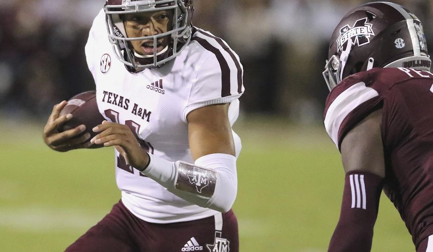 Texas A&M quarterback Kellen Mond (11) sprints for additional yardage while trying to avoid the tackle by Mississippi State cornerback Jamal Peters (2) during the first half of their NCAA college football game on Saturday, Oct. 27, 2018, in Starkville, Miss. (AP Photo/Jim Lytle)