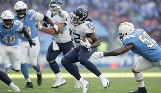 FILE - In this Oct. 21, 2018, file photo, Tennessee Titans running back Derrick Henry (22) carries the ball during an NFL football game against the Los Angeles Chargers in London. Henry has talked a very good game on the kind of running back he wants to be for the Titans. The 2015 Heisman Trophy winner knows it's time he starts proving it. (AP Photo/Matt Dunham, File)