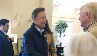 In this Wednesday, Oct. 31, 2018, file photo, Democratic candidate for governor Ned Lamont greets people during a campaign stop in Mystic, Conn. (AP Photo/Susan Haigh)