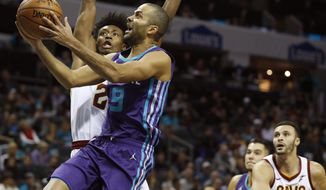 Charlotte Hornets' Tony Parker (9) shoots as he is fouled by Cleveland Cavaliers' Collin Sexton (2) during the first half of an NBA basketball game in Charlotte, N.C., Saturday, Nov. 3, 2018. (AP Photo/Bob Leverone)