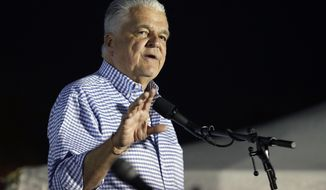 Clark County Commission Chair and Democratic gubernatorial candidate Steve Sisolak speaks at a rally Friday, Nov. 2, 2018, in Las Vegas. (AP Photo/John Locher)