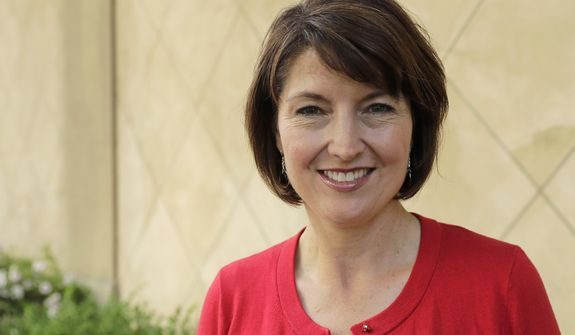 In this Aug. 22, 2018 photo, U.S. Rep. Cathy McMorris Rodgers, R-Wash., poses for a photo in Spokane, Wash. McMorris Rodgers, who is fourth in House leadership and the highest ranking woman in the GOP, is facing a formidable challenge in the 5th Congressional District from Democrat Lisa Brown. (AP Photo/Ted S. Warren)