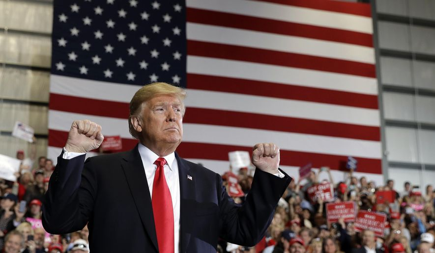 President Donald Trump looks to the crowd after speaking at a campaign rally at Pensacola International Airport, Saturday, Nov. 3, 2018, in Pensacola, Fla. (AP Photo/Evan Vucci)