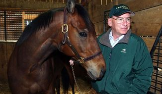 FILE - In this April 6, 2004 file photo, Michael Blowen prepares to take Rich in Dallas out of his stall on Afton farm near Midway, Ky.,  Rich in Dallas was one of the horses that played Seabiscuit in the film of the same title. Blowen is the founder of Old Friends, a new nonprofit organization devoted to providing a retirement home for thoroughbred stallions and other racehorses when their careers have ended. (AP Photo/James Crisp, File)