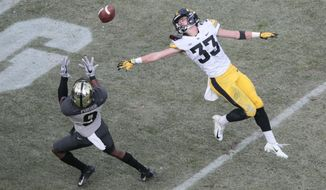 Iowa defensive back Riley Moss (33) defends againsta pass intended for Purdue wide receiver Terry Wright (9) in the first half of an NCAA college football game in West Lafayette, Ind., Saturday, Nov. 3, 2018. Wright scored a touchdown on the play. (AP Photo/AJ Mast)