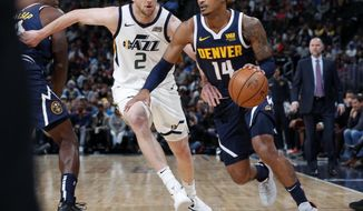 Denver Nuggets guard Gary Harris, right, drives past Utah Jazz forward Joe Ingles during the first half of an NBA basketball game Saturday, Nov. 3, 2018, in Denver. (AP Photo/David Zalubowski)
