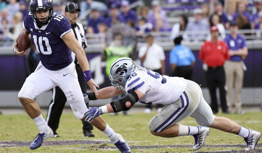 TCU quarterback Mike Collins, left, scrambles to avoid Kansas State's Wyatt Hubert during the fourth quarter of an NCAA college football game Saturday, Nov. 3, 2018, in Fort Worth, Texas. (Bob Haynes/Star-Telegram via AP)