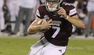 Mississippi State quarterback Nick Fitzgerald (7) looks for running room during the first half of an NCAA college football game against Louisiana Tech, Saturday, Nov. 3, 2018, in Starkville, Miss. (AP Photo/Jim Lytle)