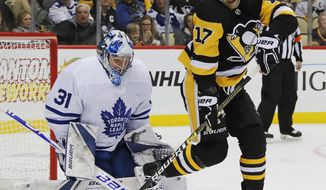 Pittsburgh Penguins' Bryan Rust (17) can't redirect a shot in front of Toronto Maple Leafs goaltender Frederik Andersen (31) who makes the save during the second period of an NHL hockey game in Pittsburgh, Saturday, Nov. 3, 2018. (AP Photo/Gene J. Puskar)