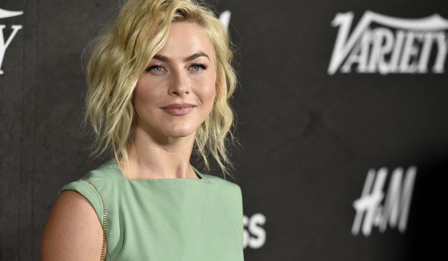 "FILE - In this Aug. 28, 2018 file photo, Julianne Hough arrives at Variety's Power of Young Hollywood in Los Angeles. Hough is the other woman. The multi-hyphenate performer will play Jolene in Netflix's upcoming anthology series based on Dolly Parton music. ""Dolly Parton's Heartstrings"" will consist of eight episodes, each inspired by one of Parton's famous songs.In the ""Jolene"" version, Hough will play a free-spirit with big dreams to leave her small town. ""Dolly Parton's Heartstrings"" is scheduled to debut next year. (Photo by Chris Pizzello/Invision/AP, File)"