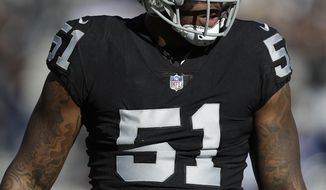 FILE - In this Dec. 3, 2017, file photo, Oakland Raiders outside linebacker Bruce Irvin (51) waits for a play by the New York Giants during an NFL football game in Oakland, Calif. The Raiders are planning to cut Irvin after the team's leading pass rusher's playing time was significantly reduced in recent weeks. A person familiar with the decision said Saturday, Nov. 3, the move should be official next week. The person spoke on condition of anonymity because the team hadn't announced the transaction. The Athletic first reported the decision. (AP Photo/Marcio Jose Sanchez, File)