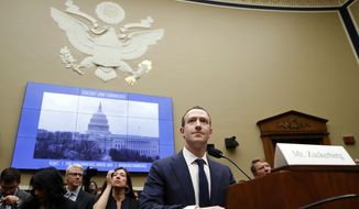 FILE - In this April 11, 2018 file photo, Facebook CEO Mark Zuckerberg returns after a break to continue testifying at a House Energy and Commerce hearing on Capitol Hill in Washington, about the use of Facebook data to target American voters in the 2016 election and data privacy. Facebook and other social platforms have been waging a fight against online misinformation and hate speech for two years. With the U.S. midterm elections coming soon on Tuesday, Nov. 6, there are signs that they're making some headway, although they're still a long way from winning the war. (AP Photo/Jacquelyn Martin, File)