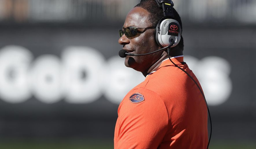 Syracuse head coach Dino Babers watches the action in the first half of an NCAA college football game against Wake Forest in Charlotte, N.C., Saturday, Nov. 3, 2018. (AP Photo/Chuck Burton)