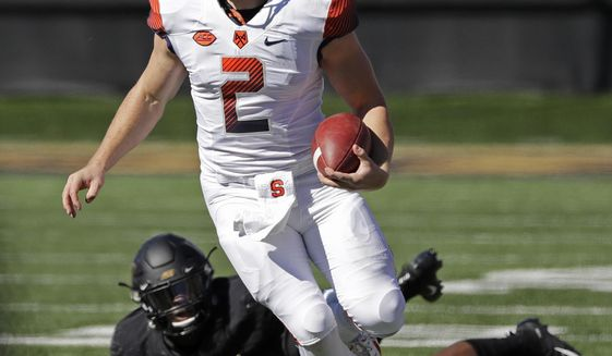 Syracuse's Eric Dungey (2) scrambles against Wake Forest in the first half of an NCAA college football game in Charlotte, N.C., Saturday, Nov. 3, 2018. (AP Photo/Chuck Burton)