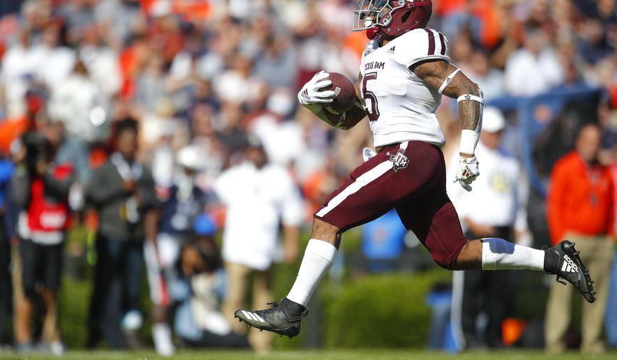 Texas A&M running back Trayveon Williams (5) rushes for a touchdown against Auburn during the first half of an NCAA college football game, Saturday, Nov. 3, 2018, in Auburn, Ala. (AP Photo/Todd Kirkland)