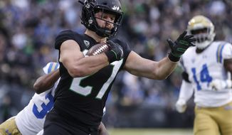 Oregon tight end Jacob Breeland (27), scores a touchdown on a fake field goal attempt against UCLA during an NCAA college football game in Eugene, Ore., Saturday, Nov. 3, 2018 (AP Photo/Thomas Boyd)