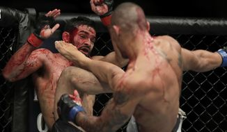 Sheymon Moraes, right, lands a kick on Julio Arce during the second round of a featherweight mixed martial arts bout at UFC 230 on Saturday, Nov. 3, 2018, at Madison Square Garden in New York. (AP Photo/Julio Cortez)