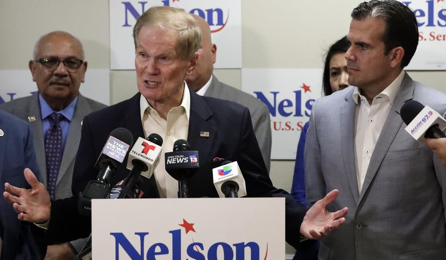 This Oct. 2, 2018 file photo shows U.S. Sen. Bill Nelson, left, speaking to supporters after he was endorsed by Puerto Rico Governor Ricardo Rossello, right, during a news conference in Orlando, Fla. Nelson is facing Florida Gov. Rick Scott. (AP Photo/John Raoux)