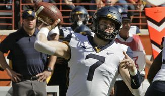 West Virginia quarterback Will Grier throws the ball during the first half of an NCAA college football game against Texas, Saturday, Nov. 3, 2018, in Austin, Texas. (AP Photo/Michael Thomas)