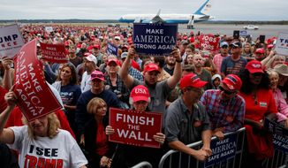 Supporters listen as President Trump speaks during a campaign rally for Republican gubernatorial candidate Brian Kemp on Sunday in Macon, Georgia. (Associated Press)