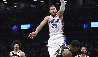 Philadelphia 76ers guard Ben Simmons (25) dunks over Brooklyn Nets forward Rondae Hollis-Jefferson (24) as Nets center Jarrett Allen (31) and guard Spencer Dinwiddie (8) look on during the first half of an NBA basketball game, Sunday, Nov. 4, 2018, in New York. (AP Photo/Kathleen Malone-Van Dyke)