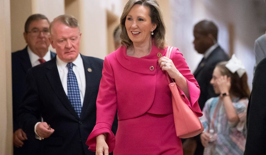 In this June 26, 2018, file photo, Rep. Barbara Comstock, R-Va., walks to a closed-door GOP strategy session at the Capitol in Washington. Two-term Rep. Barbara Comstock of Virginia is one of the most vulnerable Republicans in Congress in a year when Democrats are hoping to pick up dozens of seats and take control of the House of representatives. Democrat Jennifer Wexton, a state senator and former prosecutor, won a six-way primary for the right to take on Comstock in a northern Virginia district that has been held by the GOP for nearly 40 years. (AP Photo/J. Scott Applewhite, File)