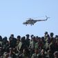 An Afghan National Army  helicopter flies over soldiers during a military training exercise at Kabul Military Training Center, in Kabul, Afghanistan, Wednesday, Oct. 22, 2014. Taliban insurgents have stepped up their attacks against both Afghan and NATO security forces as most international security forces prepare to withdraw by the end of the year. (AP Photo/Massoud Hossaini)