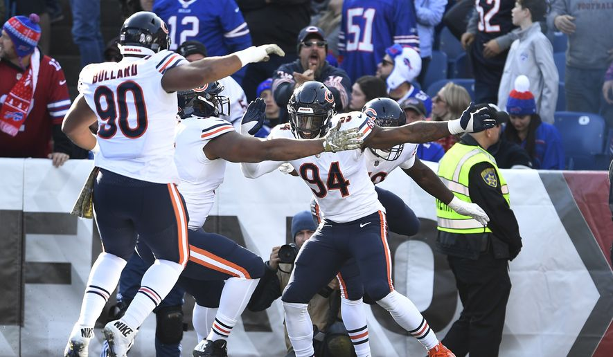 Chicago Bears outside linebacker Leonard Floyd (94) celebrates with teammates after intercepting a pass to score a touchdown during the first half of an NFL football game against the Buffalo Bills Sunday, Nov. 4, 2018, in Orchard Park, N.Y. (AP Photo/Adrian Kraus)