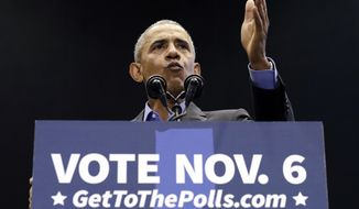 Former President Barack Obama speaks during a rally to support Indiana Democratic U.S. Senate candidate, Sen. Joe Donnelly at Genesis Convention Center in Gary, Ind., Sunday, Nov. 4, 2018. (AP Photo/Nam Y. Huh) **FILE**