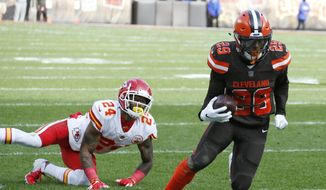 Cleveland Browns running back Duke Johnson (29) breaks free from Kansas City Chiefs strong safety Jordan Lucas (24) for a 19-yard touchdown during the first half of an NFL football game, Sunday, Nov. 4, 2018, in Cleveland. (AP Photo/Ron Schwane)